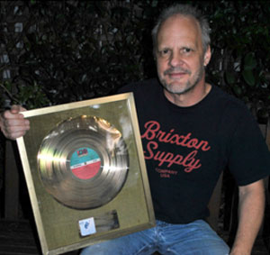 bassist Mark Evans auctions AC/DC Gold Record for Sydney soccer team